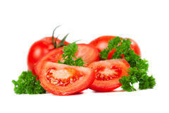 Cut tomatoes into slices with parsley leaves Stock Image