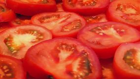 Cut Tomatoes Turning Slowly. Closeup of tomato slices rotating stock video