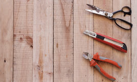 Cut of tools on wooden background Stock Photos