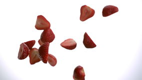 Strawberries. Cut in two pieces of strawberries flying in air down in slow motion tabletop 1080 stock footage