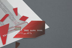 Cut up Credit Card on Bank Statement Stock Photo