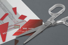 Cut up Credit Card and Scissors Royalty Free Stock Image