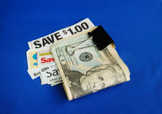 Cut up some coupons. To save money Royalty Free Stock Image