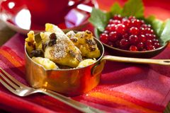 Cut-up and sugared pancake. With raisins and red currants stock photography
