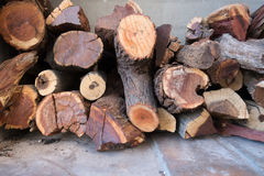 Cut up timber piled for use as firewood. royalty free stock photography