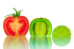 The cut vegetables and fruit, isolated on a white background Royalty Free Stock Photo