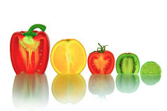 The cut vegetables and fruit, isolated on a white background Royalty Free Stock Images