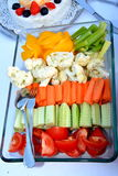Cut vegetables. A glass bowl with various cut vegetables served: peppers, celery, cauliflower, carrot, cucumber and tomato Royalty Free Stock Image