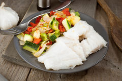 Cut vegetables and grilled fish in classic wood Royalty Free Stock Images
