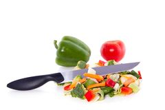 Cut vegetables with a knife on top Royalty Free Stock Image