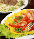 The cut vegetables lie on a plate. Image of festive food, The cut vegetables lie on a plate Stock Photo