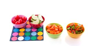 Cut vegetables plastic bowls Royalty Free Stock Images
