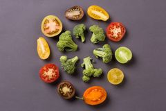 Cut vegetables - tomato, broccoli on grey background Royalty Free Stock Image