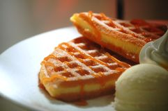 Cut Waffles. Cut of waffles served with maple syrup and ice cream Stock Images