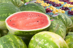 Cut Watermelon on Display in a pile at a farmers market Royalty Free Stock Image