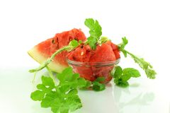 Cut watermelon fruit and leaves Royalty Free Stock Images