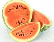 Cut watermelon on a glass tray Stock Photos