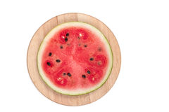 Cut watermelon. On wooden board isolated Stock Photography