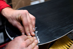 Cut wax. Snowboard in service. cut wax Royalty Free Stock Photography
