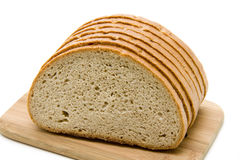 Cut wheat bread. And on edge board royalty free stock photography
