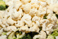 Cut white cauliflower with broccoli Stock Image