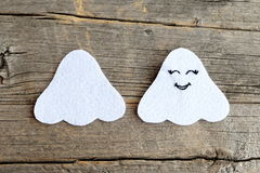 Cut from white felt details for making Halloween ghost doll.  Step by step tutorial. Old wooden background Royalty Free Stock Photo