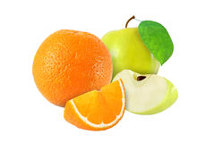 Cut and whole apple with leaf and orange fruits isolated Royalty Free Stock Photos