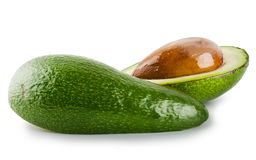 Cut and whole avocado Stock Images