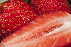 Cut and whole fresh fruits of red strawberry, close up Stock Photos