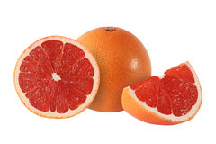 Cut and whole grapefruit fruits  on white. Background Royalty Free Stock Image