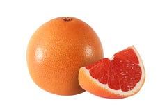 Cut and whole grapefruit fruits on white. Background royalty free stock photo