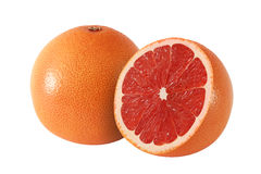 Cut and whole grapefruit fruits  on white. Background Stock Image