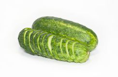 Cut and whole green cucumbers Royalty Free Stock Photos