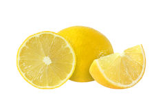 Cut and whole lemon fruits isolated on white background.  Royalty Free Stock Photography
