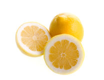 Cut and whole lemons. On white background Royalty Free Stock Photos