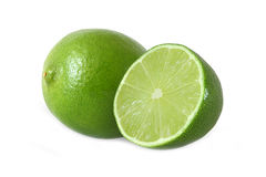 Cut and whole lime fruits isolated on white. Background Royalty Free Stock Image