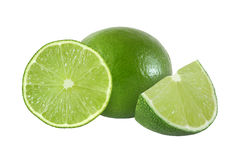 Cut and whole lime fruits isolated on white background Royalty Free Stock Images