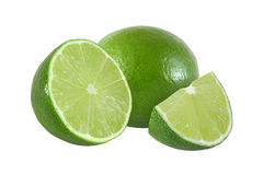 Cut and whole lime fruits isolated on white background Royalty Free Stock Photos