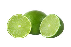Cut and whole lime fruits isolated on white background Stock Photos
