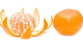 Cut and whole mandarine Stock Photos