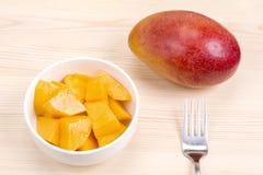 Cut and whole mango Royalty Free Stock Image