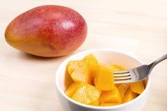 Cut and whole mango Stock Images
