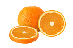 Cut and whole orange fruits isolated on white. Background Royalty Free Stock Image