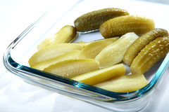 The cut and whole pickles Royalty Free Stock Photography