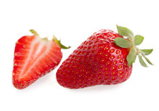 Cut and whole strawberry Stock Photos