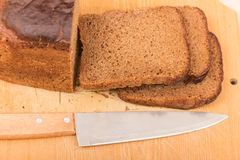 Cut wholemeal bread and knife Royalty Free Stock Photo
