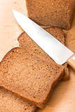 Cut wholemeal bread and knife Stock Photography