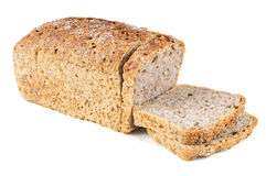 Cut wholemeal bread on white background Royalty Free Stock Photos
