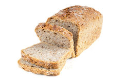 Cut wholemeal bread on white background Royalty Free Stock Image