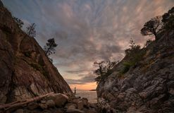 The cut in Whytecliff Park, a rock wall formation that leads straight to the ocean. stock photography